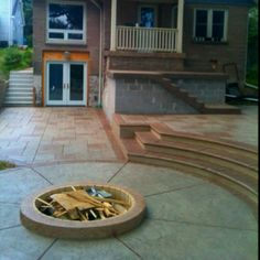 New stamped concrete patio with gas fire pit