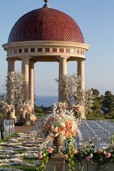 Weekend Destination Wedding at The Resort at Pelican Hill | PelicanHill.com | destination wedding, wedding, wedding planning, wedding venue, pelican hill, pelican hill resort, pelican hill wedding, pelican hill resort wedding, colorful wedding, floral design aisle, orange and white florals, outdoor ceremony, ocean view