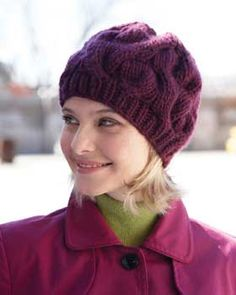 Warm, stylish hat with wide cables. Shown in Bernat Roving.