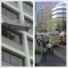 Sydney Window Cleaners Rescued A window cleaner hangs precariously from a gurney outside the AON building on George St, Parramatta.