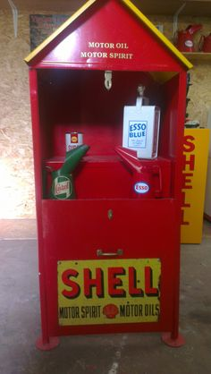 Vintage motor oil cabinet with shell branding