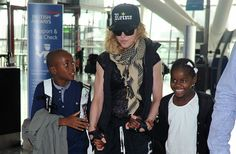 Singer Madonna with two of her four children, adopted son David & daughter Mercy**