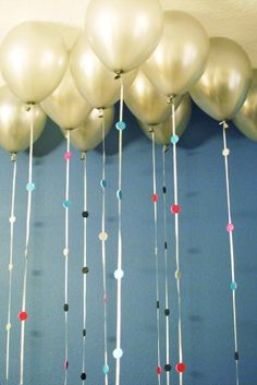 Sparkly Balloon Garland - use sparkle foam sheets with an adhesive backing and a circle punch. Punch out as many circles as possible, stick  the circles together on each side of the string, and voilà, instant upgraded party balloons.
