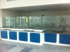 Miami International Airport Ticket Counter - A-Christian Glass Installation with Blue Glass