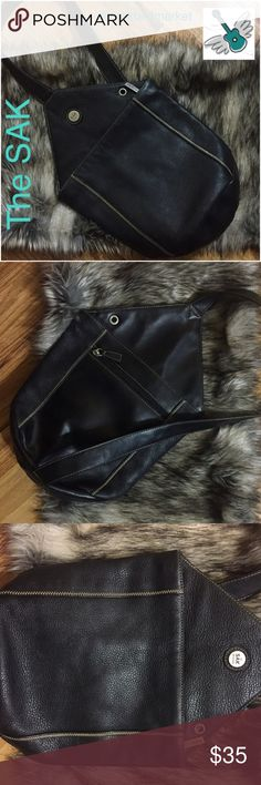 """The SAK, leather sling backpack/shoulder bag-rare! Excellent condition with very light signs of use. The interior is clean and very slightly worn as seen in photo. Exterior is gorgeous pebbled black leather. The bag is about 13"""" long from point to bottom. Interior width is about 4"""". Strap is non-adjustable and is about 32"""" long. All three zippers work perfectly. I am a five star closet and a suggested user. Check my reviews and buy with confidence!  Thank you. The Sak Bags"""