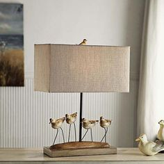 This Crestview Collection shore birds table lamp measures and features a coastal bird design. It comes with a x linen shade. Wipe clean with dry cloth, no chemicals. Coastal Bathrooms, Coastal Living Rooms, Coastal Curtains, Coastal Decor, Coastal Lighting, Coastal Entryway, Coastal Chandelier, Coastal Farmhouse, Modern Coastal