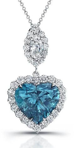 Blue Heart Cut Diamond Necklace Surrounded In Brilliant Cut Diamonds, Set In Platinum