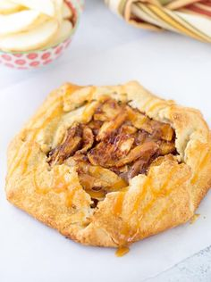 This rustic apple galette with caramel sauce has a spiced apple pie filling baked inside a flaky, buttery crust drizzled with caramel sauce! #recipe #apple
