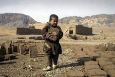 Casualties of War - An Afghan child carries a brick at a factory on the outskirts of Herat, west of Kabul, February 11th, 2012. Thousands of Afghan children work to make money to support their families.