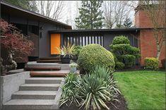 midcentury modern exterior paint - very dark grey and orange door. Exterior Paint Colors, Exterior House Colors, Paint Colors For Home, Exterior Stairs, Paint Colours, Mid Century Ranch, Mid Century House, Modern Exterior, Exterior Design