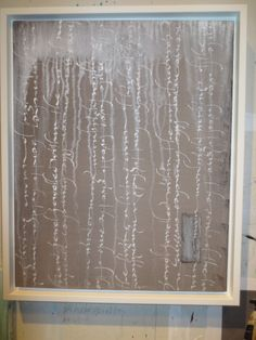 Getting ready for our exhibition: Calligraphy, Georgia Angelopoulos; Painting, Miles Lowry. Text: Miles Lowry. Moon gold and mineral pigments on canvas.