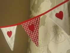 Soft white cord with red appliqué cord hearts...