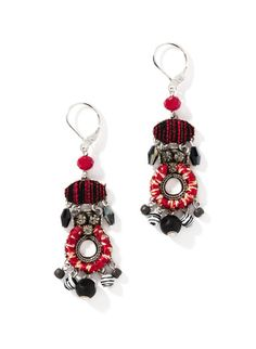 The chandelier earrings mix fabric-covered beads and facet-cut glass.
