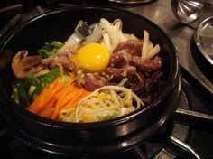 Maangchi: Korean Cooking has the very best recipe for BiBimBap!  Easy to understand and easy to find ingredients.