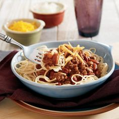 Cincinatti chili.  What makes this flavorful beef chili unique is that it's served over hot cooked noodles...give it a try - it just may become your favorite way to eat chili!