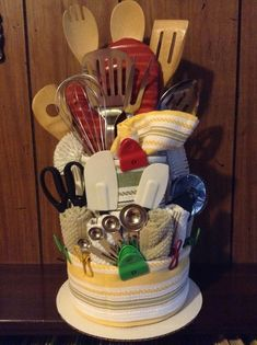 Kitchen dish towel cake my mom and I made as a wedding gift for a coworker of he. Kitchen dish towel cake my mom and I made as a wedding gift for a coworker of hers. Dish Towel Cakes, Kitchen Towel Cakes, Kitchen Gift Baskets, Housewarming Gift Baskets, Kitchen Gifts, Kitchen Towels, Dish Towels, Themed Gift Baskets, Raffle Baskets