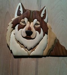 Wolf made of mahogany, aspen, pine, yellow heart and wenge. Design by Judy Gale Roberts