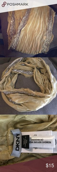 Dkny infinity scarf Super fun tan infinity scarf with silver sequin detail. Excellent condition Dkny Accessories Scarves & Wraps