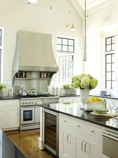 Height became the focus of this charming kitchen, with soaring ceilings and extra-tall casement windows boosting the natural light and bright feel.