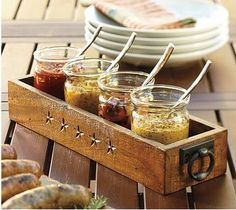 Jennifer Rizzo: condiment serving idea for a party (could use vintage sewing machine drawer and mason jars)