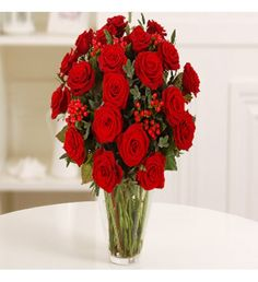 Red roses are the classic symbol of love and this luxurious bouquet of 20 stunning deep red Grand Prix roses arranged with red hypericum berries and pretty silvery eucalyptus foliage is the perfect way to celebrate Valentine's Day with your loved one.