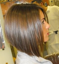 Angled bob hairstyle. I am never going to have long hair again. What a mistake that was! Love my short hair.
