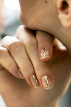 Le Fashion Blog Gold Glitter Striped Nails Nail Art Holiday New Years Inspiration Backstage Delpozo FW 2015
