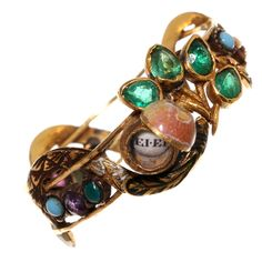 "Our Garden of Eden Serpent Ring features multi-colored gemstones and paste set in gold. The apple opens and inside reads "" Ei Ei "", which in Finnish means ""No No"". 19th century jewelry."