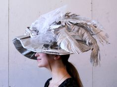 The Modern Woman Wears Knowledge: Victorian-inspired women's hat made from newspaper and book pages. By Alicia Kovalcheck.