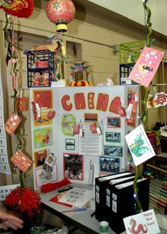 World Thinking Day - China Display - China's booth featured some super cute decor. They handed out chopsticks, lucky red Chinese New Year envelopes and fortune cookies along with their SWAPs.