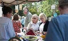 Cris Pattee and Debbie Hytton check out Jessica Tescher's glass art during last year's Takin' It to the Streets. The Fall Arts Festival event showcases work by artists from Jackson Hole and nearby towns.