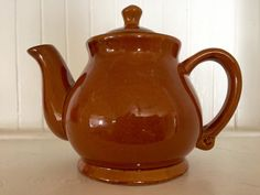 A personal favorite from my Etsy shop https://www.etsy.com/listing/261968335/brown-teapot-ceramic-teapot-vintage