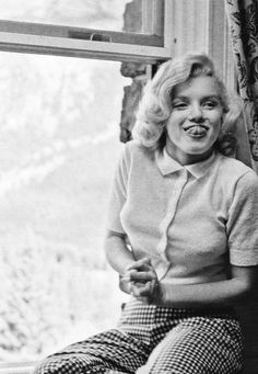 """Marilyn Monroe, 1950′s """"This is a little kid who wants to be with the other little kids sucking lollipops and watching the rollercoaster, but she can't because they won't let her. She's frightened to death of that public which thinks she is so sexy...."""