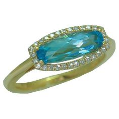 Blue Topaz Ring with 0.12 cttw. Diamonds https://www.goldinart.com/shop/rings/colored-gemstone-rings/blue-topaz-ring-with-012-cttw-diamonds