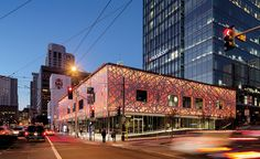 The prosaic city garage at 690 Folsom Street in downtown San Francisco had been neglected for decades, but a recent makeover is attracting attention. Wrapped with a new layer of intricately cut white-painted aluminum and backlit by color-changing LEDs, the building now scintillates with a play of light and shadow that enlivens one of the city's major roads.