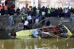 (AP)- Rescue workers prepare to pull a bus out of a canal in Marioutiya, west of Cairo, Egypt, Saturday, March 21, 2015. Over 10 workers were killed when their bus plunged into the canal Saturday morning, according to a health official. (AP Photo/Ahmed Ramadan)