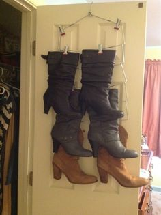 Boot storage! Just did this with a multi-skirt hanger.