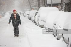 Stock Photo : Man enjoying snow in city and walking in street