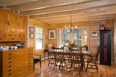 Log Home Dining Room Featuring Exposed Ceiling Joist.