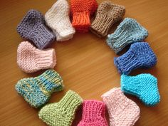 Ravelry: Easy Knitted Booties pattern by Bundles of Love Free Pattern: going to become kitten mittens!