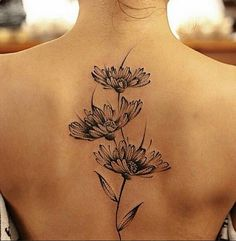 Black white daisy tattoo