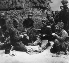Russian prisoners of war play a game of cards on the Eastern Front during World War I, circa 1915