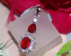 Vintage design pendant with created ruby and Diamond, $19.99