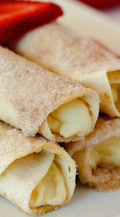 Cheesecake Taquitos have a silky-smooth cheesecake filling wrapped inside a crispy flour tortilla that's been rolled in cinnamon and sugar! Sweets Recipes, Fun Desserts, Mexican Food Recipes, Snack Recipes, Cooking Recipes, Mexican Desserts, Yummy Recipes, Yummy Food, Best Breakfast Recipes