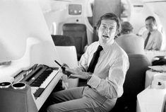 Available for sale from Isabella Garrucho Fine Art, Terry O'Neill, Roger Moore Electric Piano, 72 × 48 in Terry O Neill, Luxury Private Jets, Electric Piano, Roger Moore, Richard Branson, Brigitte Bardot, Rolling Stones, Bad Boys, The Beatles