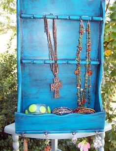 Turn an old spoon display into jewelry display.  My $1.00 thrift store find repurposed!