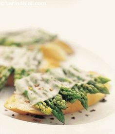 Crispy french bread slices topped with asparagus and cheese. The bruschettas can be served as a snack or as an accompaniment to soup. Choose slender, bright green asparagus to make these bruschetta.