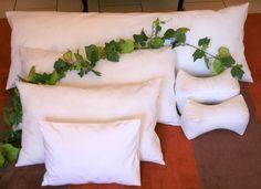 Our pillow range includes: (clockwise from the bottom);  Mini pillow [33cm x 47cm]   Standard pillow [45cm x 70cm]   Queen pillow [50cm x 80cm] King size pillow [50cm x 90cm]   Euro-Continental [63cm x 63cm]  Body pillow [50cm x 150cm]   reading pillows [30cm x 15cm]  Buy Now online:- http://allfinerthings.wozaonline.co.za/
