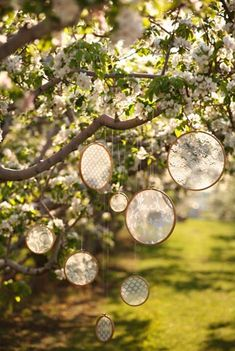 love this idea! hanging little things from trees! very... whimsical :) i would hang all sorts of things like forks and mirror shards and seashells