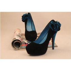 Black high heels with a flower/ruffle thing on the side